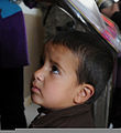 An Afghan boy looks up at an interpreter while waiting to receive school supplies during Operation School Supplies Nov. 10, 2011, at Bagram Airfield, Afghanistan 111110-A-DY116-005.jpg