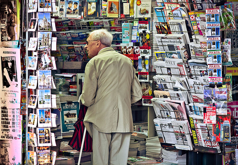 File:An old man in newsagent's shop, Paris September 2011.jpg