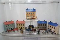 Antique toy carriages and houses (26648622426).jpg
