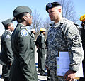 Army Reserve Master Sgt. Israel Sanchez conducts a uniform inspection.jpg