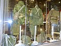 Army uniforms of Norway. Post WW2 British battle dress; field uniform M1951 American style; M1975 with 1980s equipment. Helmets Jackets Caps Gaiters Boots Belts Webbing Backpacks Pouches etc Forsvarsmuseet Oslo 2020-02- 3308.jpg