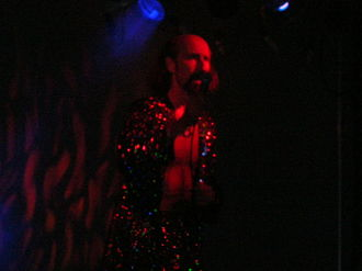 "Shock rock - Arthur Brown in 2005. During live performances and in the promotional television video, Brown performed the 1968 song ""Fire"" wearing black and white makeup (corpse paint) and a burning headpiece."