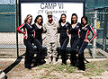 Atlanta Falcons cheerleaders pose in front of Camp 6, Guantanamo, with Lucky GI.jpg