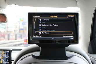 Multi Media Interface - MMI interface, music section, display integrated in front right side seat, view from rear seat, 2014 Audi A8