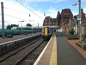 Ayr railway station - Ayr Railway Station, with Class 380 380006 at Platform 1 and Aviation Fuel tankers at Platform 3