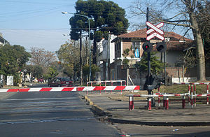 Grade crossing signals - Grade crossing signal with flashing lights and gates by GRS. The device is still active in Florida Oeste, Buenos Aires.