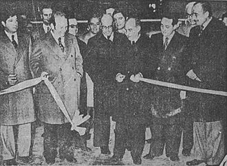 Papel Prensa - Bartolomé Mitre IV of La Nación (2nd from left), Industry Secretary Raymundo Podestá (holding ribbon), and Héctor Magnetto of Clarín (2nd from right) inaugurate the Papel Prensa factory in San Pedro in 1978.