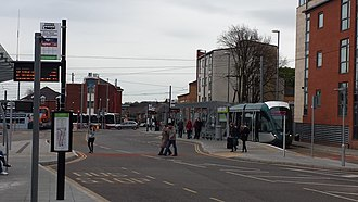Beeston transport interchange - Close-up of one of the platforms, showing bus stops (left) and tram stop (right)