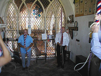 "Change ringing - Bell ringing at Stoke Gabriel parish church, Devon, England. This is in the ""ringing chamber""."