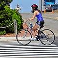 Biking Girl - Oak Bluffs MA (42097703740).jpg