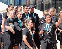 Black Ferns Kendra Cocksedge, Stacey Waaka, Selica Winiata, Victoria Subritzky-Nafatali, Eloise Blackwell, and Aldora Itunu posing for a selfie with Labour party leader.jpg