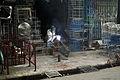 Blacksmith at work Lo Ren street (3694367427).jpg