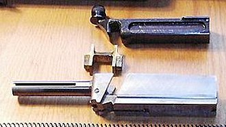 """Blish lock - Thompson M1928A1 bolt group with an """"H"""" type Blish-lock piece"""