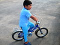 Blue clothed little cyclist boy - cycling near Nishapur railway station 04.JPG