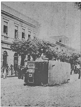 Vaccine Revolt - Streetcar overturned during the revolt.