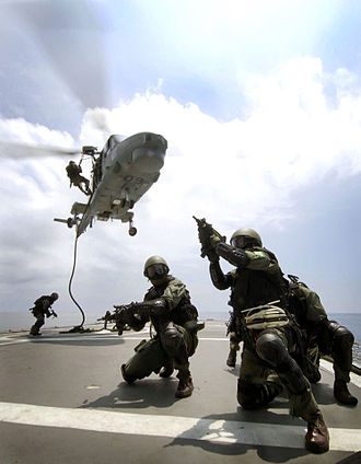 Uzi - A visit, board, search and seizure team attached to the Brazilian Navy frigate Independencia rappels onto a ship from a Brazilian Navy Lynx helicopter during an exercise in 2007.