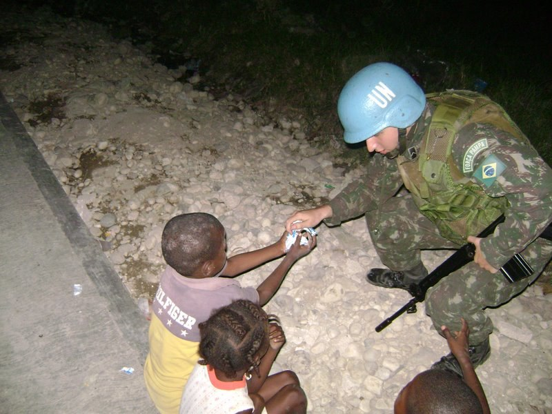 Brazilian Soldier in Haiti giving candies