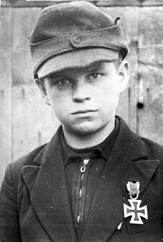Deutsches Jungvolk - 12-year-old Jungvolk platoon commander Alfred Zech (from Goldenau in Upper Silesia) earned the Iron Cross Second Class in 1945 for rescuing wounded soldiers whilst under enemy fire.