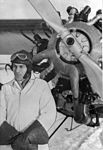 Bush pilot Charles (Cy) Becker standing in front of airplane (24695367915).jpg