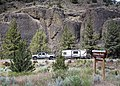 Camper drives past welcome sign for the Chimney Rock segment of the Crooked Wild and Scenic River (27561793354).jpg