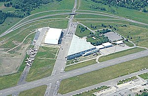 Canada Aviation and Space Museum - Aerial view of the Canada Aviation Museum as it was then known, on 5 June 2005. The triangular structure is the main museum building. The rectangular white building to the left of it is the new museum storage building opened 14 April 2005.