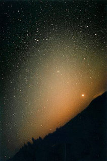 Zodiacal light glow in the night sky appearing to extend from the Suns direction and along the zodiac