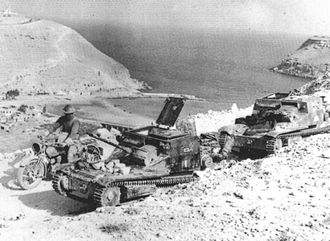 Battle of Bardia - Captured Italian L3 tankettes. In the background is the township of Bardia and its small harbour. Lower Bardia is in the middle distance; upper Bardia is atop the cliffs in the background.