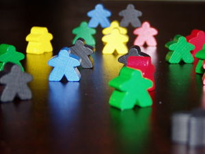 Glossary of board games - Wooden meeples from the board game Carcassonne