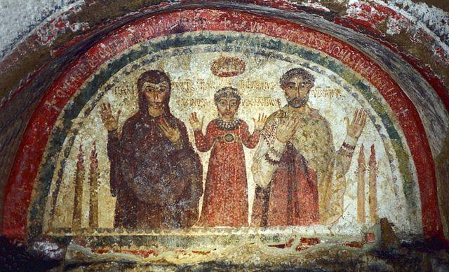 Fresque représentant une famille dans les catacombes à Naples. Photo de AIMare.