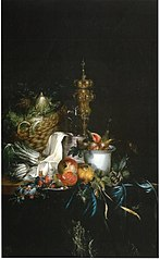 Sumptuous table with fruit and covered beaker