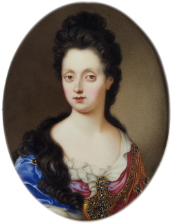 A black-haired, hazel-eyed, pale lady wears a low-cut, pink and blue, bejewelled bodice.