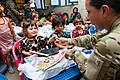 Children receive donations from ISAF DVIDS624390.jpg