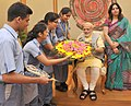 Children tying 'Rakhi' on the Prime Minister, Shri Narendra Modi's wrist, on the occasion of 'Raksha Bandhan', in New Delhi on August 29, 2015 (4).jpg