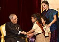 Children tying 'Rakhi' to the President, Shri Pranab Mukherjee, on the occasion of 'Raksha Bandhan', in New Delhi on August 10, 2014.jpg