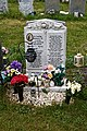 City of London Cemetery modern gravestones 3 flowers lanterns and artifacts.jpg
