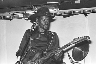 "Clarence ""Gatemouth"" Brown - Clarence ""Gatemouth"" Brown playing guitar on stage in Norway (1981)"