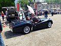 Coburger Oldtimertreffen 5. Mai 2013 - Hubertus Ernst bei der Eingangskontrolle eines Triumph TR 3 Sportwagens.jpg