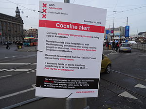 "112 (emergency telephone number) - A ""cocaine alert"" sign posted by GGD Amsterdam: the sign reminds people to ""Call 112 for an ambulance."""