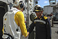 Command Master Chief James Tocorzic, command master chief of the aircraft carrier USS Theodore Roosevelt, greets Rear Adm. SV Bhokare, Flag Officer Commanding Eastern Fleet, Indian Navy.JPG