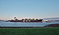 Container ship being towed in the Scheldt towards the Port of Antwerp, seen from Doel, Belgium (DSCF3886).jpg