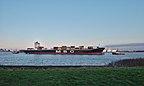 Container ship being towed in the Scheldt towards the Port of Antwerp, seen from Doel, Belgium (DSCF3886).jpg