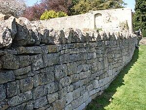 Cotswolds stone wall, Saint James Church, Chip...