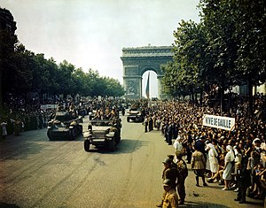 Crowds of French patriots line the Champs Elysees, 1944