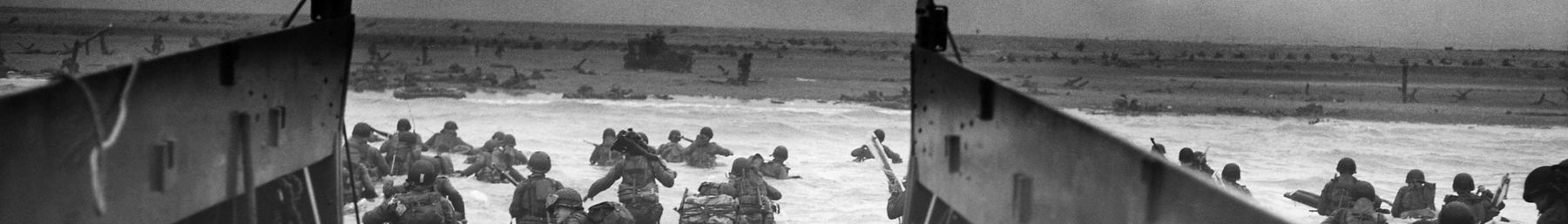 16th Infantry, 1st Infantry Division (the Big Red One) wading onto the Fox Green section of Omaha Beach