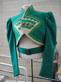 "Debbie Reynolds Auction - Emerald-green felt ""Ozmite"" jacket from ""The Wizard of Oz"".jpg"