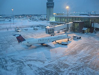 Delta Connection - A gated ERJ 145 during winter at Québec City Jean Lesage International Airport.