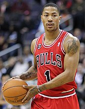 Derrick Rose holds a basketball