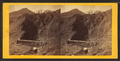 Devil's Gate from the south, the high peaks of the Wahsatch (Wasatch) in the distance. Union Pacific Railroad, from Robert N. Dennis collection of stereoscopic views 2.png