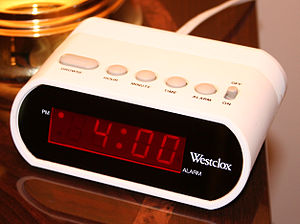 Digital clock - Basic digital alarm clock without a radio. The mark in the top-left of the display indicates that the time is 4:00pm, not 4:00am.