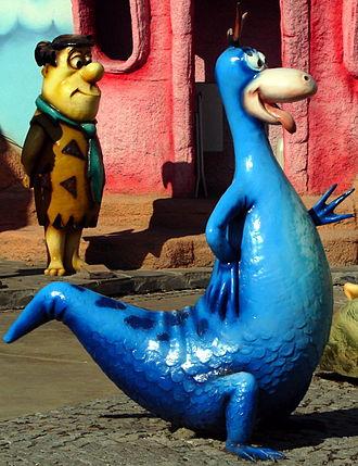 Dino (The Flintstones) - Dino statue (right), along with Fred Flintstone (left).